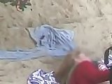Naked couples fucking on the beach by voyeur camera